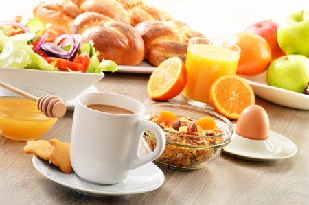 balanced diet: Breakfast including coffee, bread, honey, orange juice, muesli and fruits Stock Photo