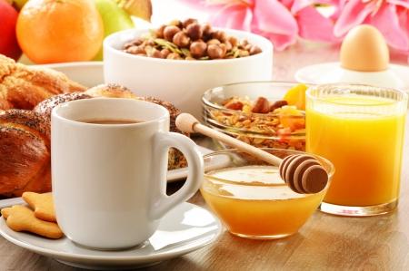 Breakfast including coffee, bread, honey, orange juice, muesli and fruits Stock Photo - 18535018