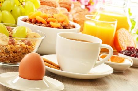 light diet: Breakfast including coffee, bread, honey, orange juice, muesli and fruits Stock Photo