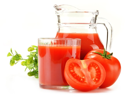 Composition with glass and jug of tomato juice isolated on white