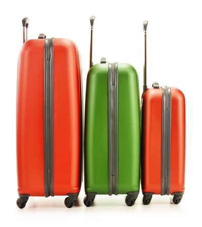 Luggage consisting of three polycarbonate suitcases isolated on white Stock Photo