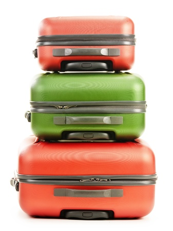 Luggage consisting of three polycarbonate suitcases isolated on white photo
