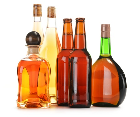 Assorted alcoholic beverages isolated on white photo