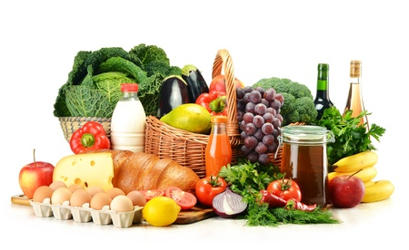 Grocery products including vegetables, fruits, dairy, bread and drinks isolated on white Stock Photo