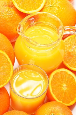 Glass and jug of orange juice and fruits Stock Photo
