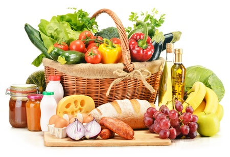 fruits basket: Assorted grocery products including vegetables fruits wine bread dairy and meat isolated on white
