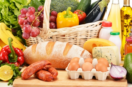varieties: Assorted grocery products including vegetables fruits wine bread dairy and meat Stock Photo