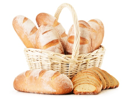 Composition with loafs of bread in wicker basket isolated on white background photo