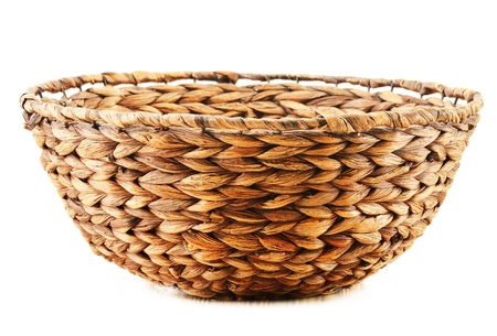 Empty wicker kitchen bowl isolated on white background photo