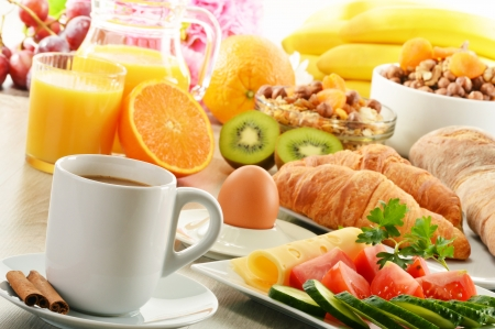 breakfast hotel: Breakfast with coffee, orange juice, croissant, egg, vegetables and fruits