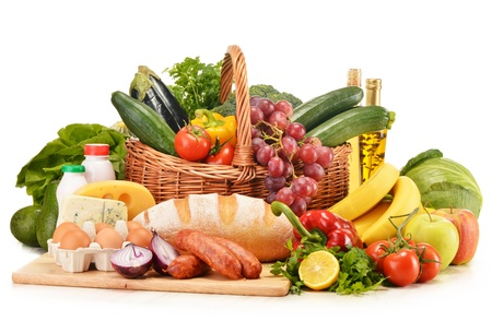 groceries: Assorted grocery products including vegetables fruits wine bread dairy and meat isolated on white