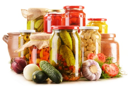 canned fruit: Composition with jars of pickled vegetables. Marinated food