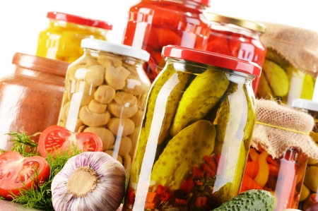 Composition with jars of pickled vegetables. Marinated food Stock Photo - 20330014