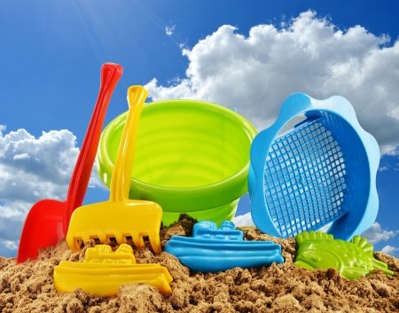 sandpit: Plastic children toys for playing in sandpit or on a beach over the blue sky