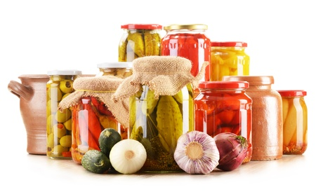 Composition with jars of pickled vegetables. Marinated food photo