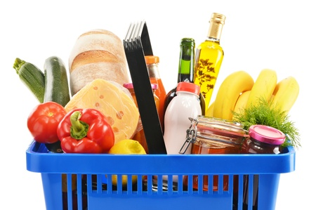 balanced diet: Plastic shopping basket with variety of grocery products isolated on white Stock Photo
