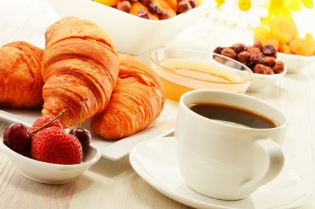 breakfast food: Breakfast with croissants, cup of coffee and fruits