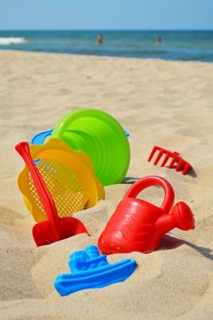 beach toys: Plastic children toys on the sand beach