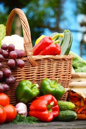 Fresh organic vegetables in wicker basket in the garden photo