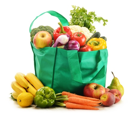 grocery bag: Green shopping bag with grocery products on white background