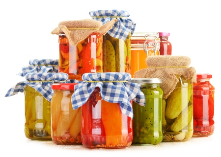 canned: Composition with jars of pickled vegetables. Marinated food