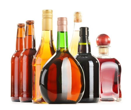 Assorted alcoholic beverages isolated on white background photo