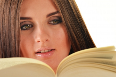 Young woman reading a book  Female student learning Stock Photo - 21075921