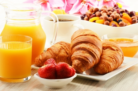 Breakfast with croissants, cup of coffee and fruits photo