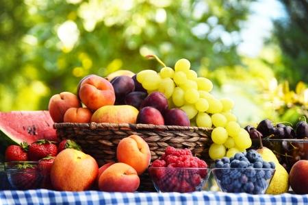 apple basket: Basket of fresh organic fruits in the garden