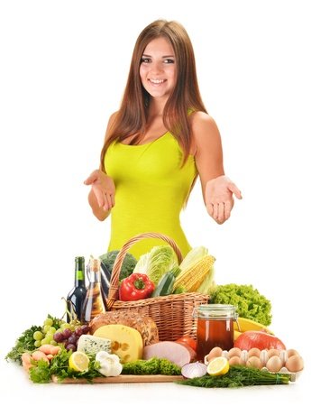 balanced diet: Young woman with assorted grocery products isolated on white background