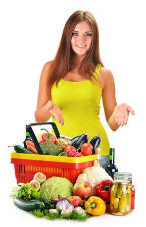 Young woman with assorted grocery products isolated on white background photo