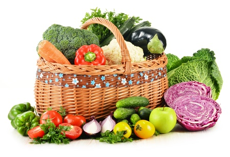 Composition with variety of fresh organic vegetables isolated on white photo