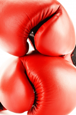prevalence: Pair of red leather boxing gloves isolated on white