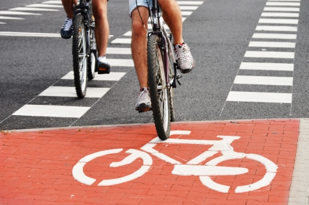 Bicycle road sign and bike riders photo