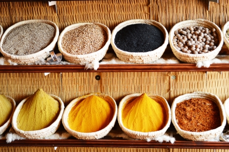 Spices in Arabic store including turmeric and curry powder photo