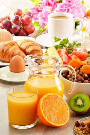 light breakfast: Breakfast with coffee, orange juice, croissant, egg, vegetables and fruits
