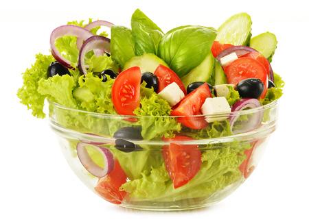 Plantaardige salade kom geà ¯ soleerd op wit Stockfoto