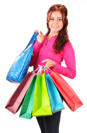 Young woman with shopping bags isolated on white background photo
