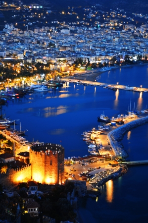 View of Alanya harbor form Alanya peninsula. Turkish Riviera by night photo