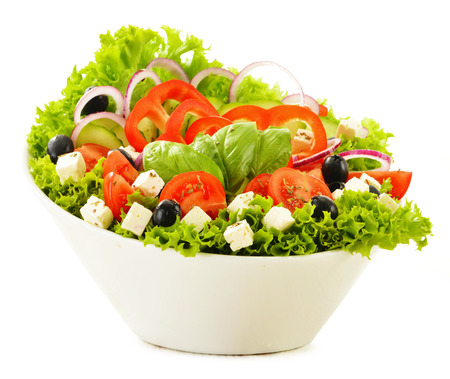 Vegetable salad bowl isolated on white background photo