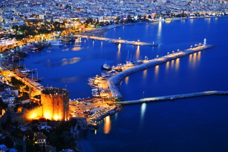 View of Alanya harbor form Alanya peninsula  Turkish Riviera by night photo