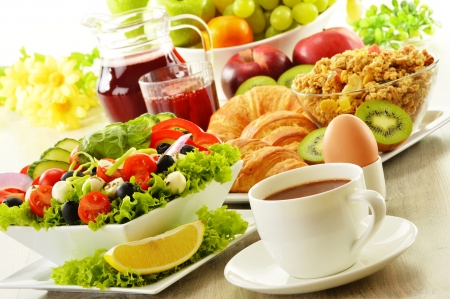 Breakfast with coffee, juice, croissant, salad, muesli and egg  Swedish buffet photo