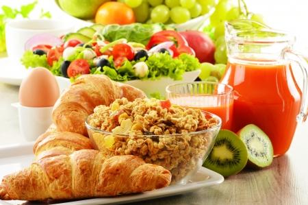 buffet table: Breakfast with coffee, juice, croissant, salad, muesli and egg  Swedish buffet