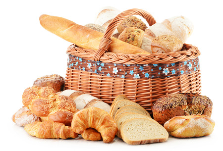 bread rolls: Wicker basket with baking products isolated on white Stock Photo
