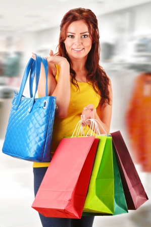 Young woman with shopping bags in the store photo