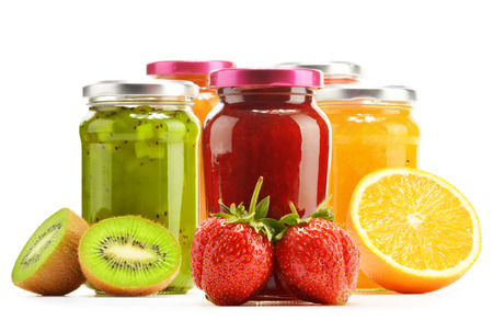 marmalade: Composition with jars of fruity jams on white. Preserved fruits