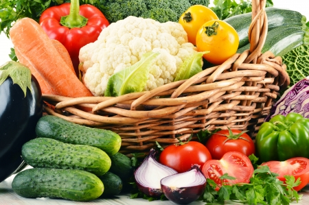 minerals food: Composition with variety of fresh organic vegetables in wicker basket