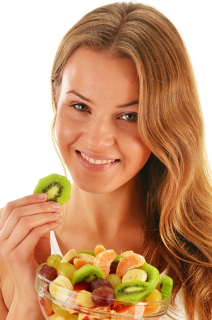 Young woman eating fruit salad photo