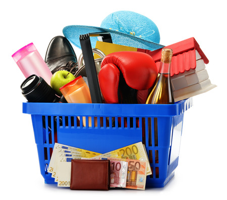 white goods: Variety of consumer products in plastic shopping basket isolated on white Stock Photo