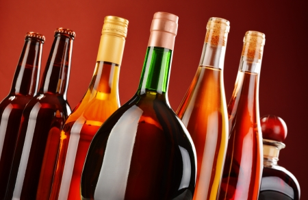 whisky bottle: Bottles of assorted alcoholic beverages